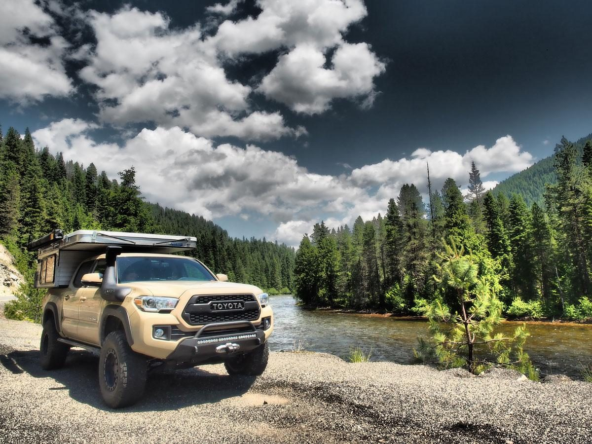 Toyota Tacoma Pop Up Truck Bed Camper Camping Set Up next to river